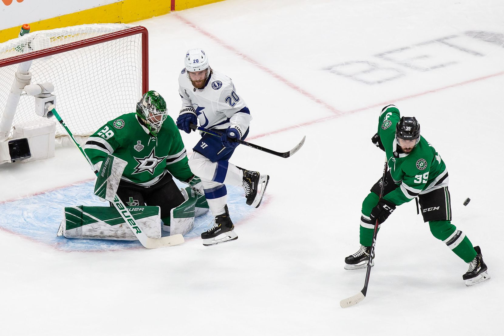 Goaltender Jake Oettinger (29) and Joel Hanley (39) of the Dallas Stars defend against Blake Coleman (20) of the Tampa Bay Lightning during Game Three of the Stanley Cup Final at Rogers Place in Edmonton, Alberta, Canada on Wednesday, September 23, 2020. (Codie McLachlan/Special Contributor)