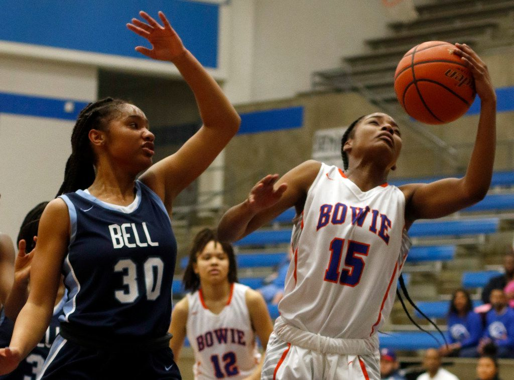 Arlington Bowie guard Alaisha Brown (15) pulls down a defensive rebound in front of Hurst L.D. Bell guard Hallie Rhodes (30) during first half action. Bell defeated Bowie 82-53 to advance. The two teams played their Class 6A bi-district girls basketball game at Grand Prairie High in Grand Prairie on February 17, 2020. (Steve Hamm/Special Contributor).