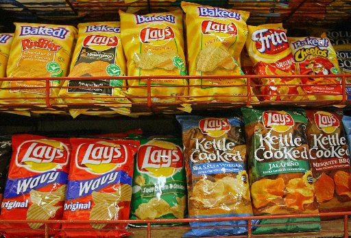 ORG XMIT: *S0417236361* PepsiCo Inc. brand chips, Frito-Lay, Lay's, and Baked Lay's, are displayed on a supermarket shelf, in New York, Tuesday, July 11, 2006. Pepsi Bottling Group Inc., the world's No. 2 soft-drink distributor, reported second-quarter profit that exceeded analysts' estimates as sales of Aquafina water and Lipton tea advanced. Photographer: Stephen Hilger/Bloomberg News. BUDGET 7/11/06 07142006xBiz