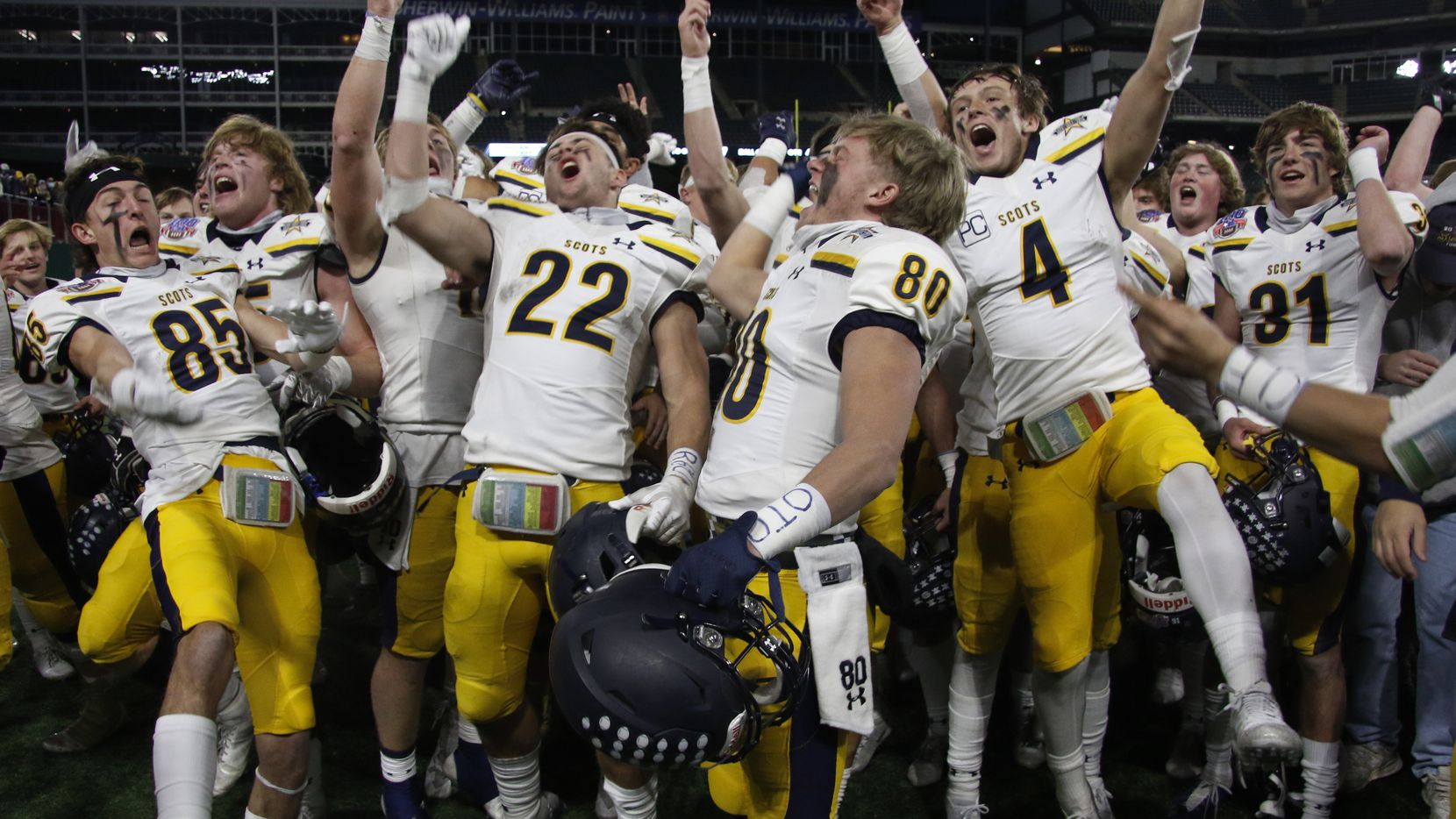 Highland Park Scots players celebrate with great intensity following their 30-20 victory over Frisco Lone Star to advance. The two teams played their Class 5A Division l Region ll semifinal football playoff game held at Globe Life Park in Arlington on December 24, 2020. (Steve Hamm/ Special Contributor)