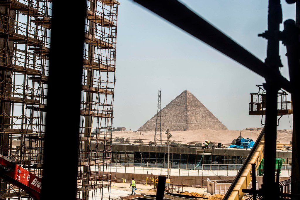 A picture taken on June 10, 2018 shows a view of construction work undergoing at the site of the Grand Egyptian Museum in Giza on the southwestern outskirts of the capital Cairo, with the Pyramid of Menkaure seen in the background.