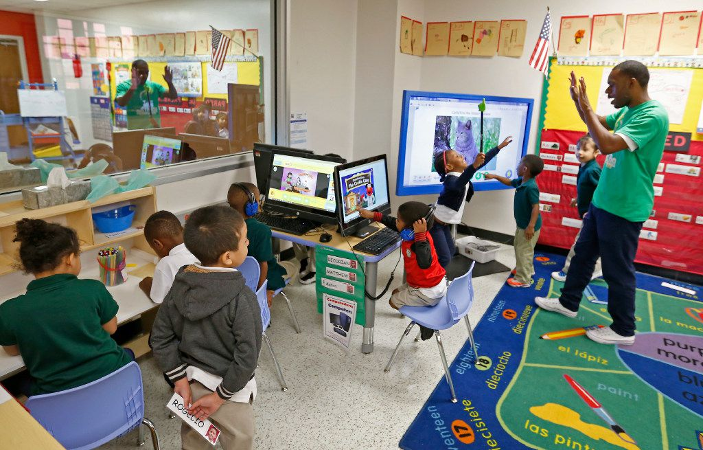 Teacher Traven Webb plays with his pre-kindergarten students in a classroom at N.W. Harllee Early Childhood Center in Dallas. (Jae S. Lee/The Dallas Morning News)