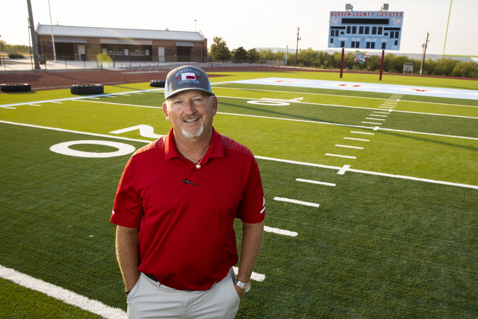 Borden County High School football coach Trey Richey poses for a photo on his field on Aug. 17, 2020 in Gail.