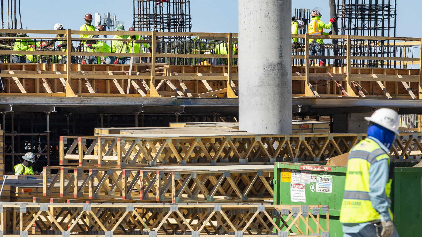 Construction personnel work on the Reata Tower on the southwest corner of Legacy Drive and Communications Parkway in Plano in June. Concerned residents who believe the city's Plano Tomorrow master plan has damaged the suburban feel of their community have been locked in litigation with Plano for almost five years.