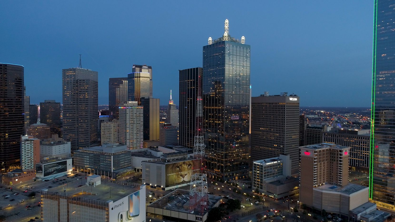 Downtown Dallas' 56-story Renaissance Tower with its lighted towers on the roof is one of the city's biggest office buildings. The building is currently facing foreclosure after defaulting on its loans.