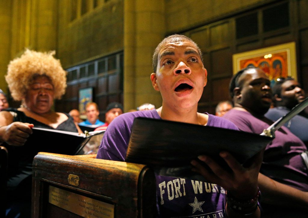 Dallas Street Choir singers Debra Scott, left rear, and Elizabeth Armstrong sings during a rehearsal for the their Carnegie Hall appearance Wednesday evening, at the Fifth Avenue Presbyterian Church in New York.