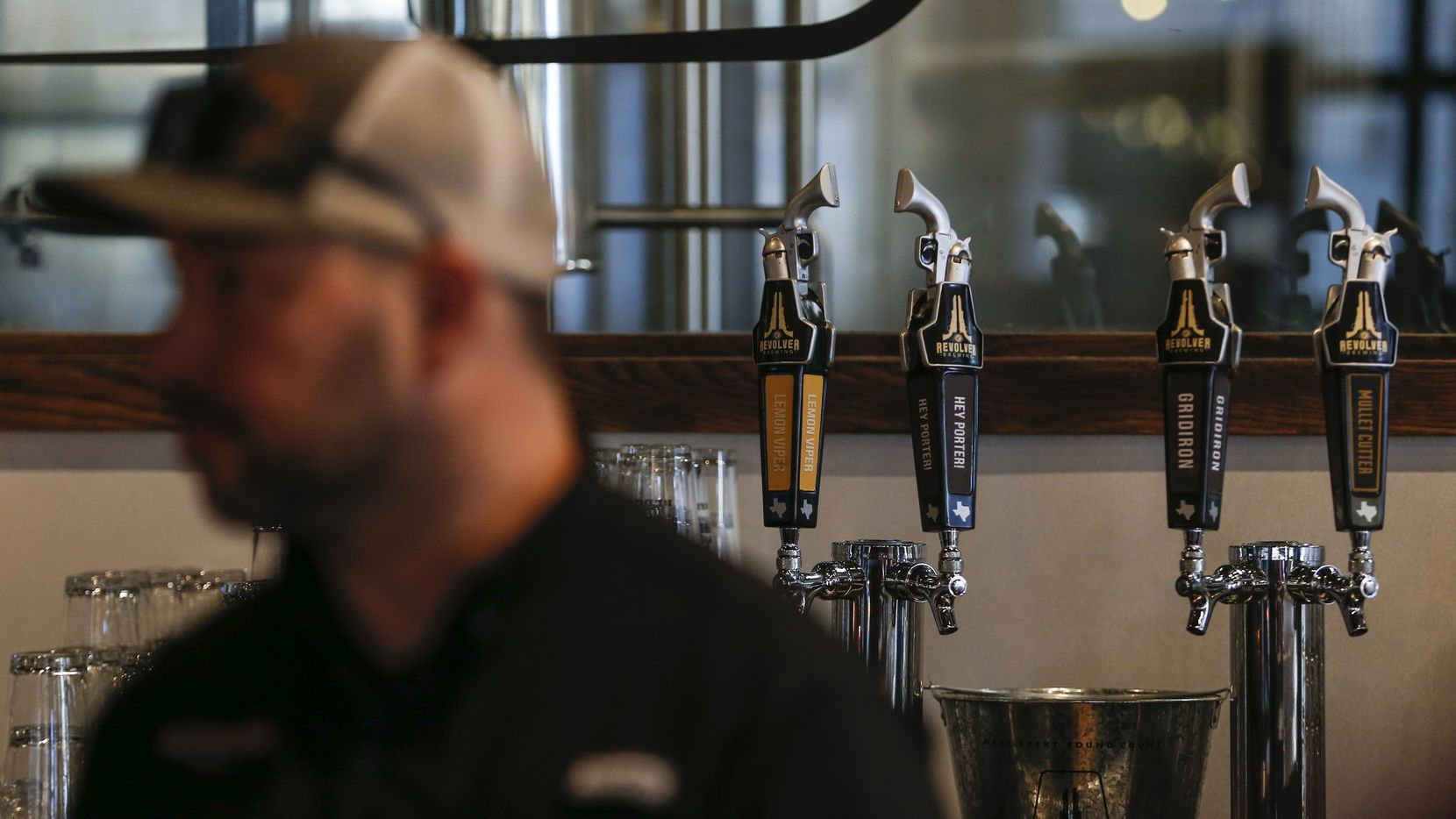 Beer taps are seen at Revolver Brewing BLDG 5, a new working brewery at Texas Live.