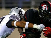 Denton Braswell running back Jaylon Burton (R) gets stopped for a short gain by Denton Guyer defensive back Marquan Pope (33) during the second half in a District 5-6A high school football game played at the C.H. Collins Complex on Friday, October 8, 2021, in Denton. (Steve Nurenberg/Special Contributor)