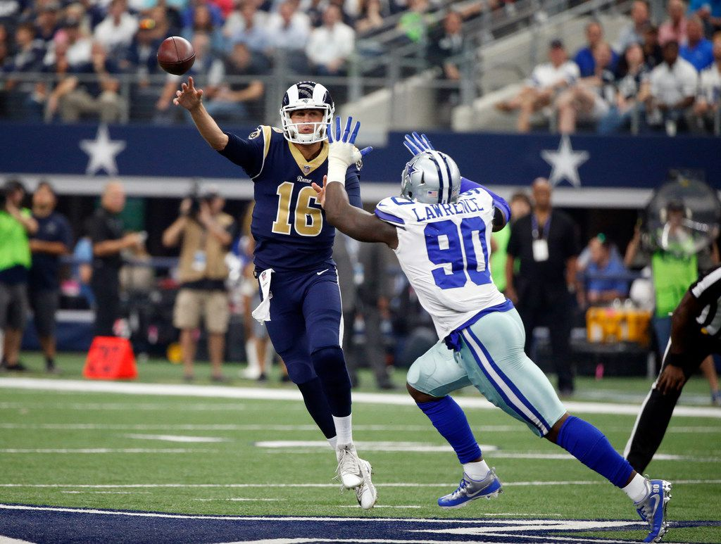 Los Angeles Rams quarterback Jared Goff (16) throws a pass under pressure from Dallas Cowboys defensive end DeMarcus Lawrence (90) in the first half of an NFL football game, Sunday, Oct. 1, 2017, in Arlington, Texas. (AP Photo/Michael Ainsworth)