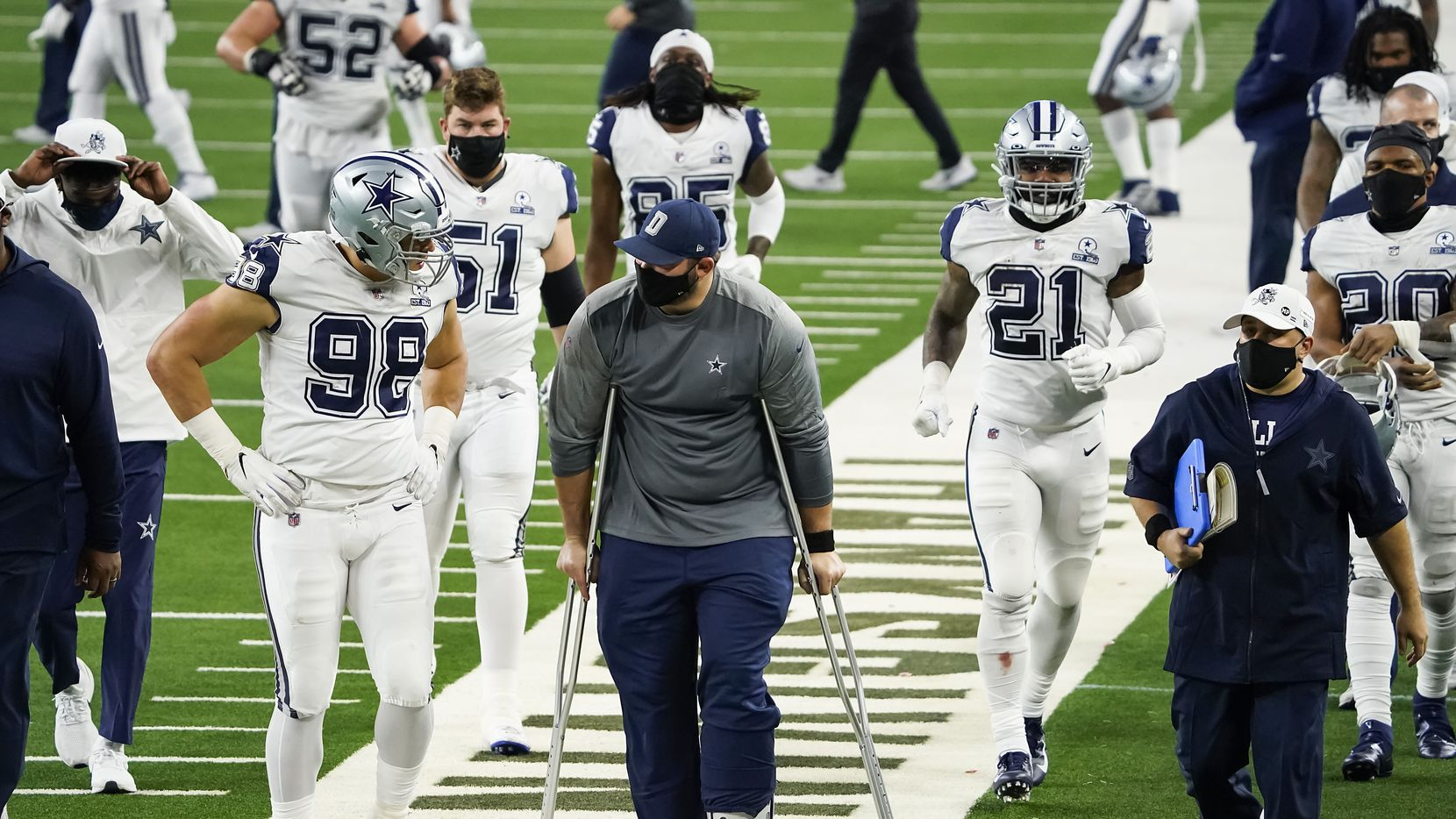 Dallas Cowboys offensive guard Zack Martin leaves the field on crutches after a 41-16 loss to the Washington Football Team an NFL football game at AT&T Stadium on Thursday, Nov. 26, 2020, in Arlington.