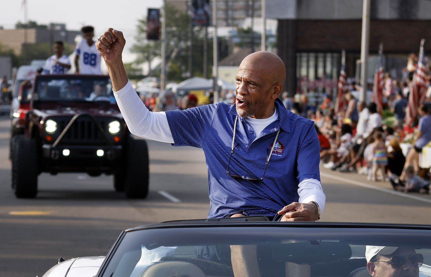 Dallas Cowboys Pro Football Hall of Fame inductee Drew Pearson fires up the fans along the Canton Repository Grand Parade route in downtown Canton, Ohio, Saturday, August 7, 2021. Family members of his rode behind him in the parade honoring newly elected and former members of the Hall, including newcomers and former Dallas Cowboys players Cliff Harris, Drew Pearson and head coach Jimmy Johnson. (Tom Fox/The Dallas Morning News)