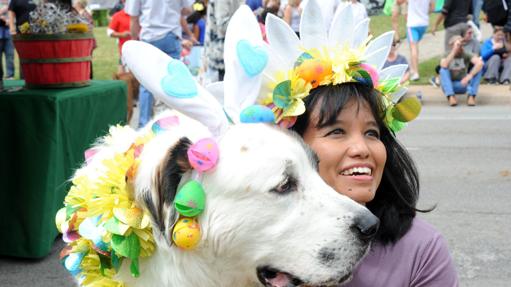 Ella and her furry  Pyrenees-St. Bernard mix dog Boo Boo relax after walking in the costume parade at Easter in the Park  in 2013.