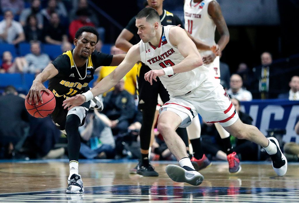 Northern Kentucky's Jalen Tate (11) and Texas Tech's Matt Mooney chase a loose ball during the second half of a first-round game in the NCAA men's college basketball tournament, Friday, March 22, 2019, in Tulsa, Okla. (AP Photo/Jeff Roberson)