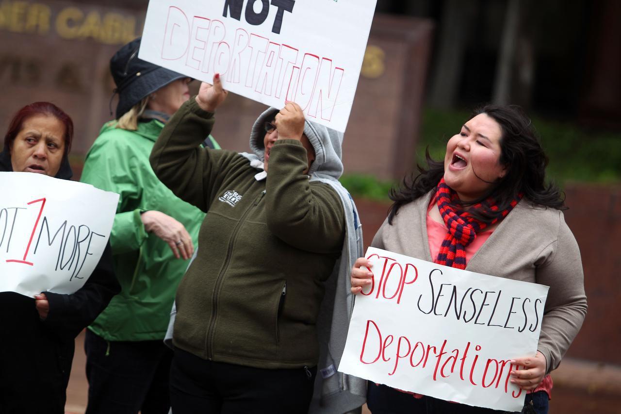 Greisa (right) demonstrated against deportations alongside her mother outside the Dallas office of Texas Sen. John Cornyn in 2013.