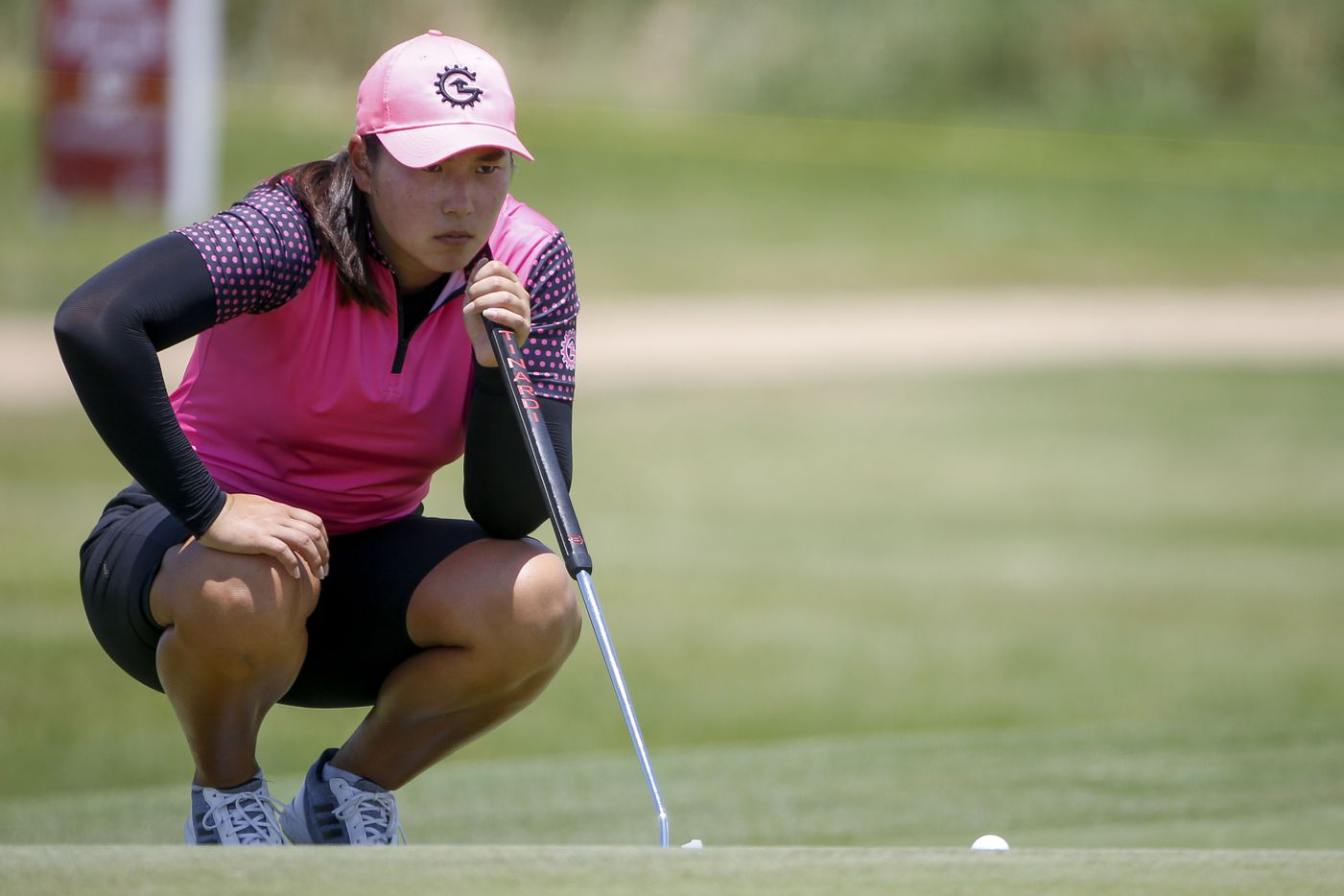 Professional golfer Min-G Kim lines up her putt on the 18th green during round one of the LPGA VOA Classic on Thursday, July 1, 2021, in The Colony, Texas. Kim finished the first day at six under par. (Elias Valverde II/The Dallas Morning News)