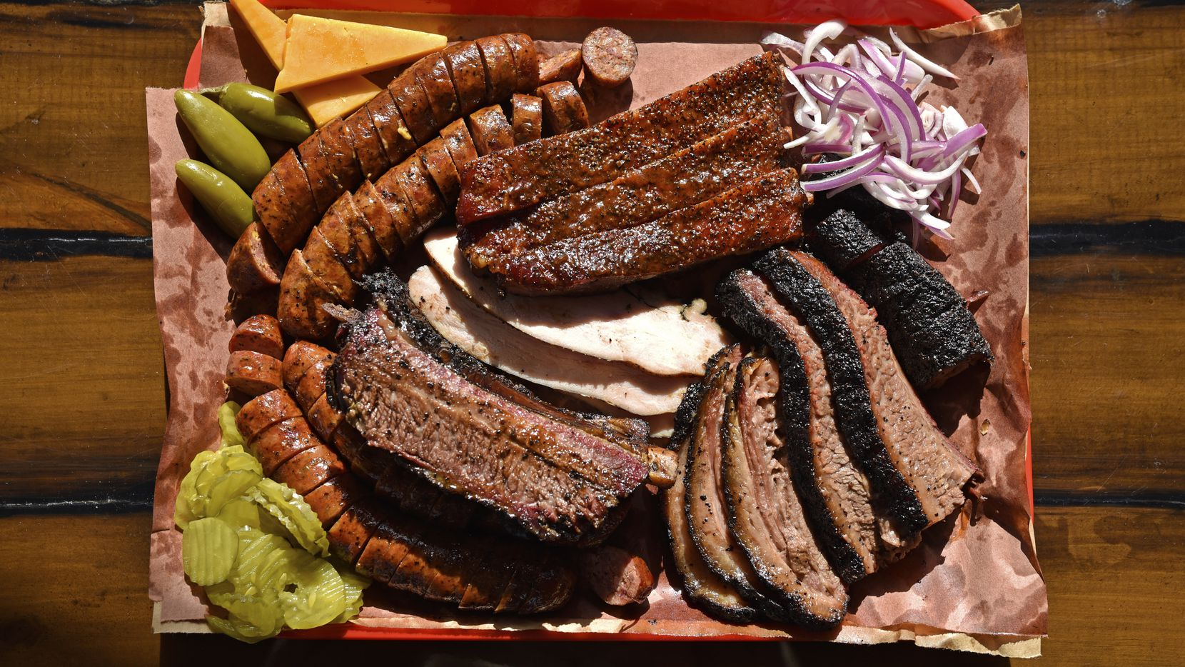 An example of what you can order at Terry Black's BBQ in Dallas, Nov. 25, 2019. The tray includes brisket, beef ribs, pork ribs, turkey, original sausage, and jalapeño cheese sausage. Ben Torres/Special Contributor
