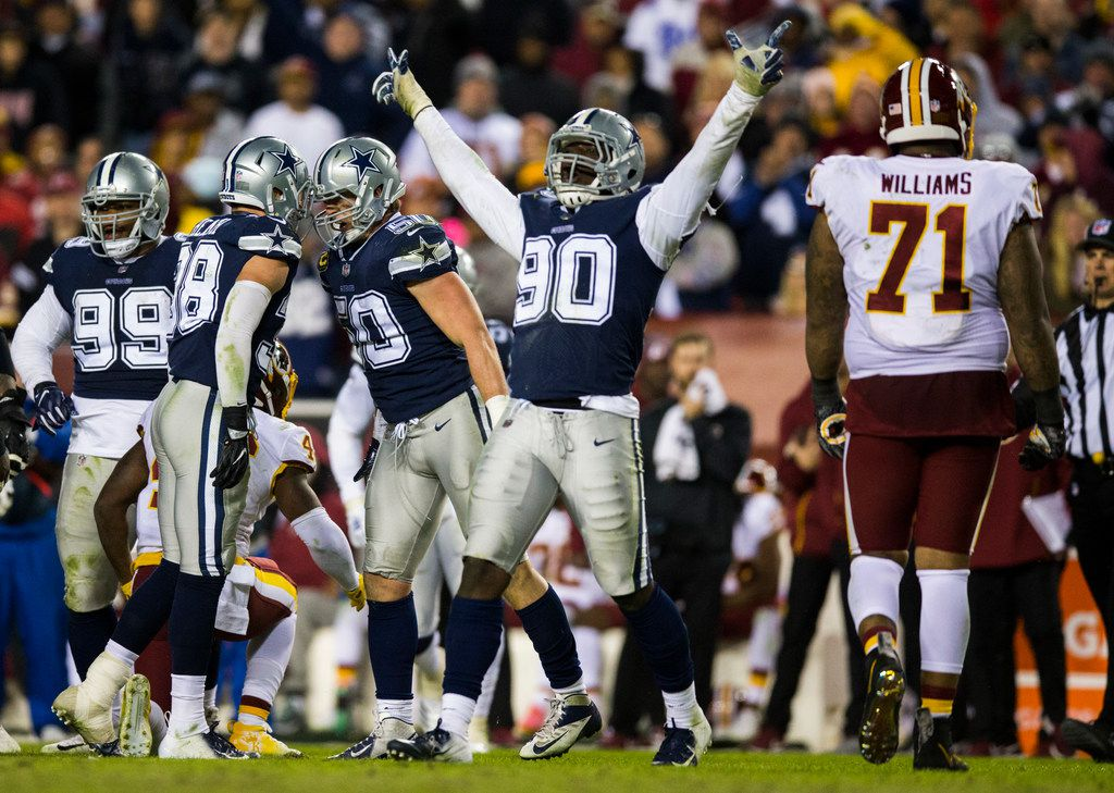 Dallas Cowboys defensive end Demarcus Lawrence (90) celebrates after a tackle during the fourth quarter of an NFL game between the Washington Redskins and the Dallas Cowboys on Sunday, October 21, 2018 in Landover, Maryland. (Ashley Landis/The Dallas Morning News)