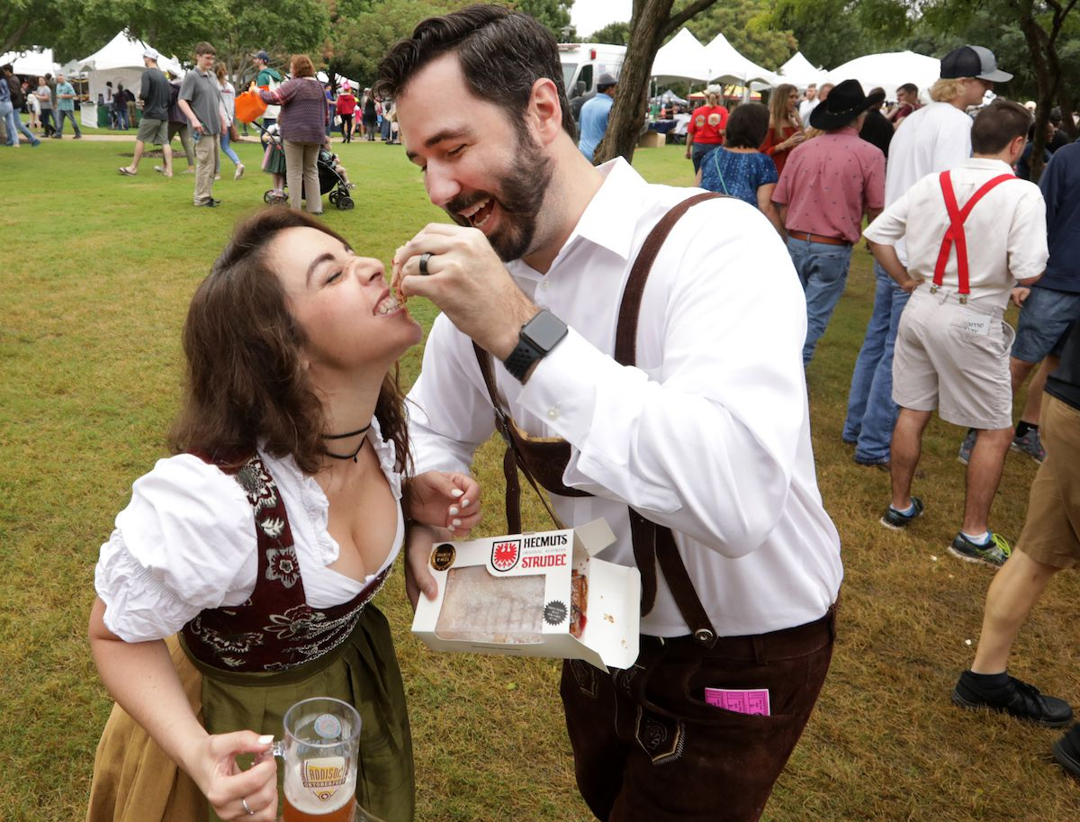 Taly Reinhart, left, and Brian Reinhart enjoy some strudel during the Addison Octoberfest in Addison, TX, on Sep. 23, 2018. (Jason Janik/Special Contributor)