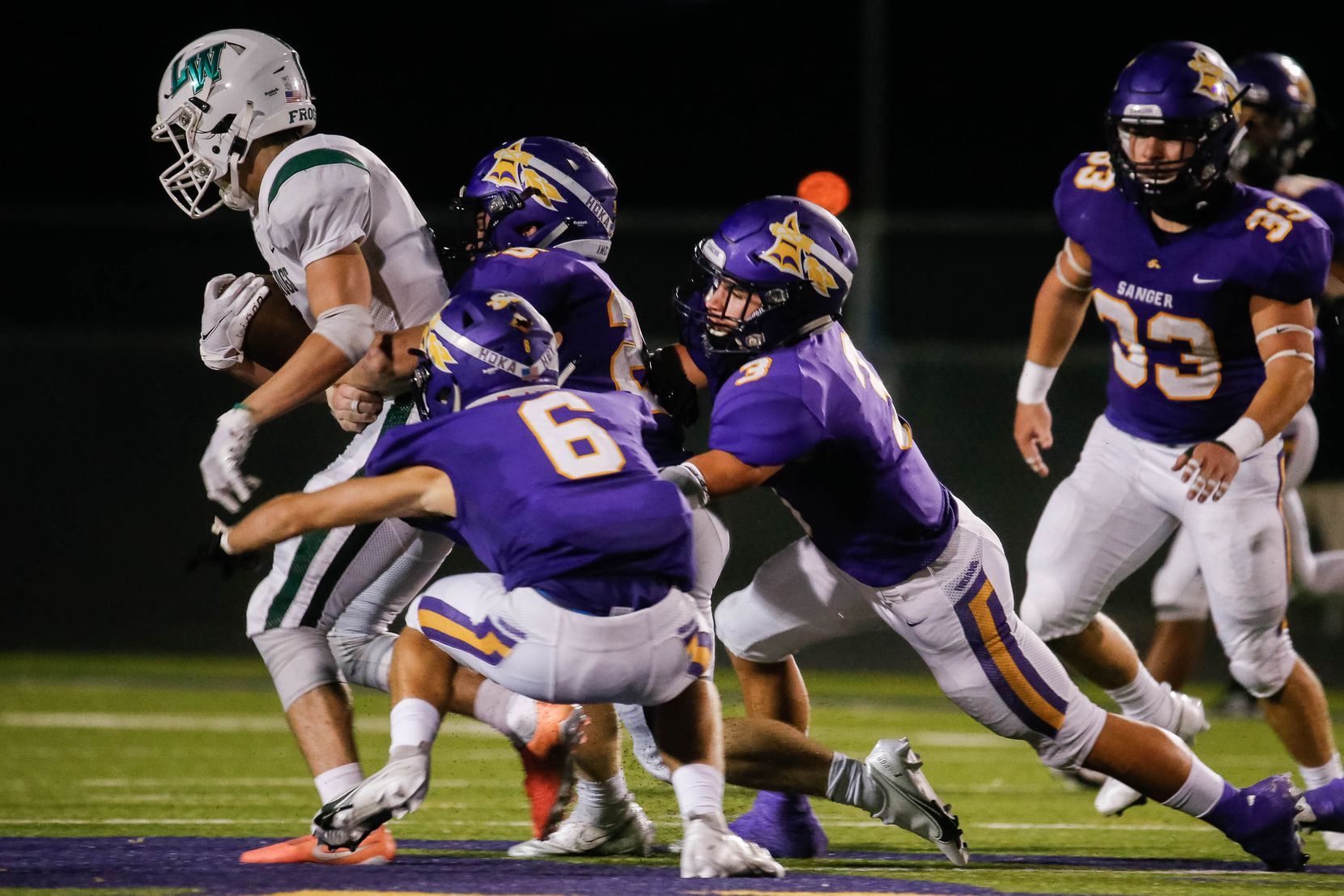 Lake Worth High School's Mark Fulkerson (5) is taken down by the Sanger High School's defense during the second half of a game on Sept. 4, 2020 in Sanger. Sanger won 49-35. (Juan Figueroa/ The Dallas Morning News)