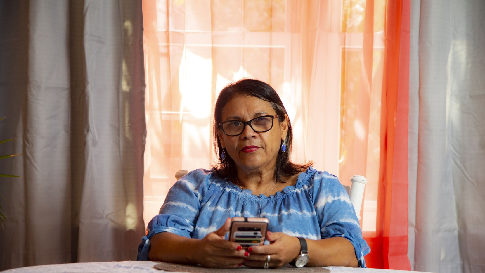 Myrna Mendez poses for a photo at her home in Dallas, Friday, September 3, 2021. Mendez sends money to her family in Mexico monthly and is part of the record-breaking flow of such money, known as remittances, into Mexico.