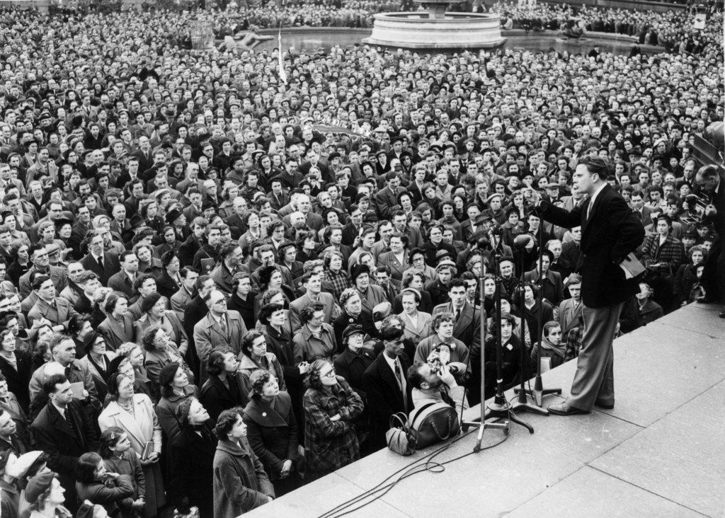 Evangelist Billy Graham addressing the congregation in Trafalgar Square in London.