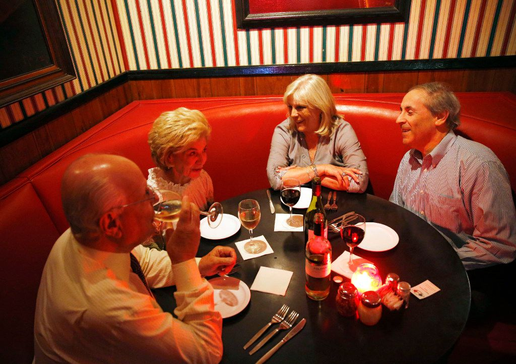 Vaughn Gross (second from left) shares a laugh with Tex Gross, Paige Flink and Randy Flink during dinner at Campisi's Egyptian Restaurant in Dallas. The Flinks have been in Dallas for 40 years and are dining out  a couple times a week at places that are as old as their time in Dallas.
