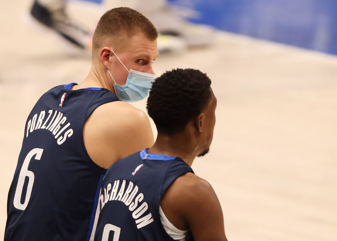 Dallas Mavericks forward Kristaps Porzingis (6) talks with Dallas Mavericks guard Josh Richardson (0) in a game against the Phoenix Suns during the second quarter of play at American Airlines Center on Monday, February 1, 2021in Dallas. (Vernon Bryant/The Dallas Morning News)