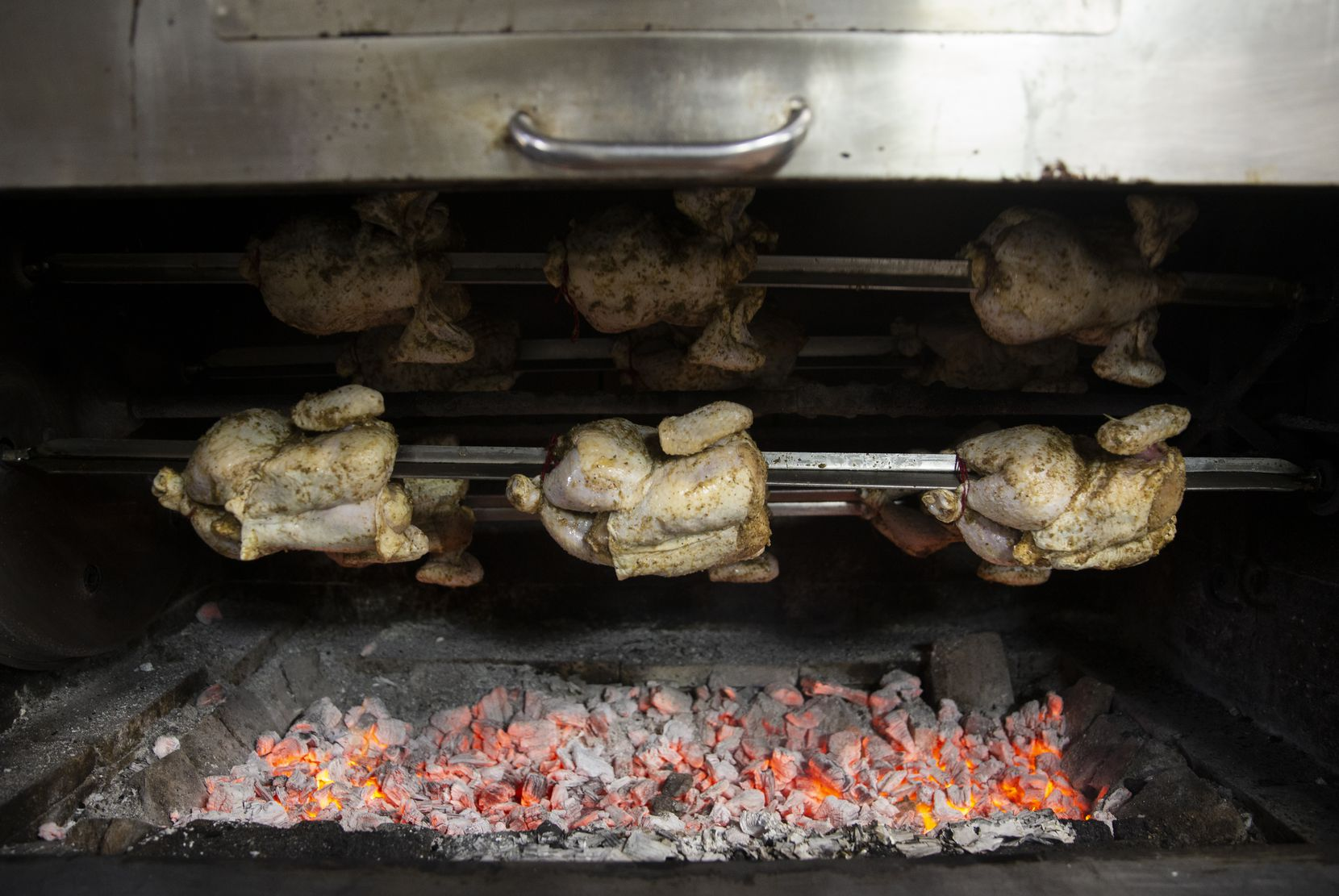 The pollo a la brasa (Peruvian roasted chicken) roasts in the oven at the Brasa Bar and Grill in Richardson.