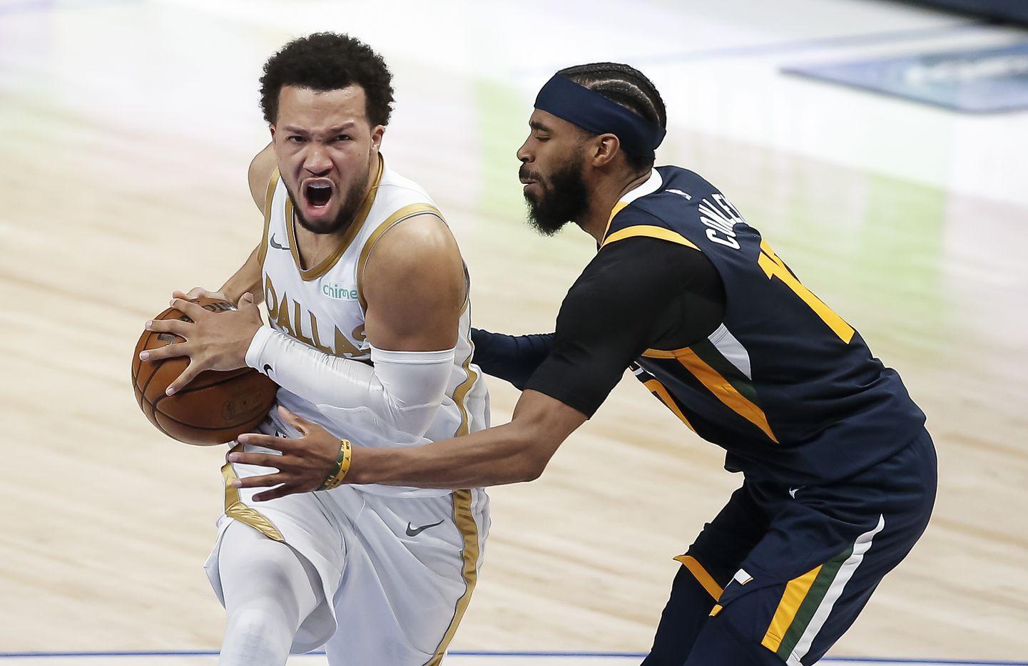 Dallas Mavericks guard Jalen Brunson (13) battles Utah Jazz guard Mike Conley (10) for space during the second half of an NBA basketball game in Dallas, Monday, April 5, 2021. Dallas won 111-103. (Brandon Wade/Special Contributor)