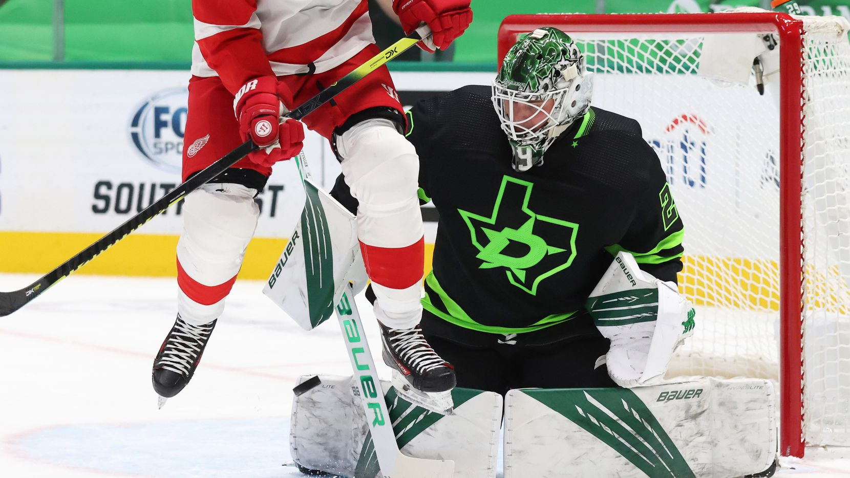 Stars goaltender Jake Oettinger (29) stops a shot on goal as Red Wings right wing Bobby Ryan (54) leaps in the air during the second period of play at American Airlines Center on Thursday, Jan. 28, 2021,in Dallas.