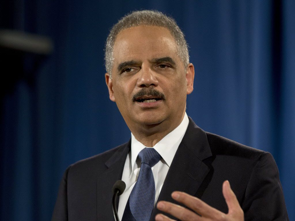 In this 2015 file photo, then-Attorney General Eric Holder speaks at the Justice Department in Washington.