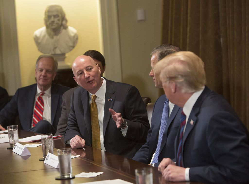 Nebraska Gov. Pete Ricketts spoke to President Donald Trump during a meeting on trade with governors and members of Congress at the White House on April 12, 2018, in Washington. (Photo by Chris Kleponis - Pool/Getty Images)