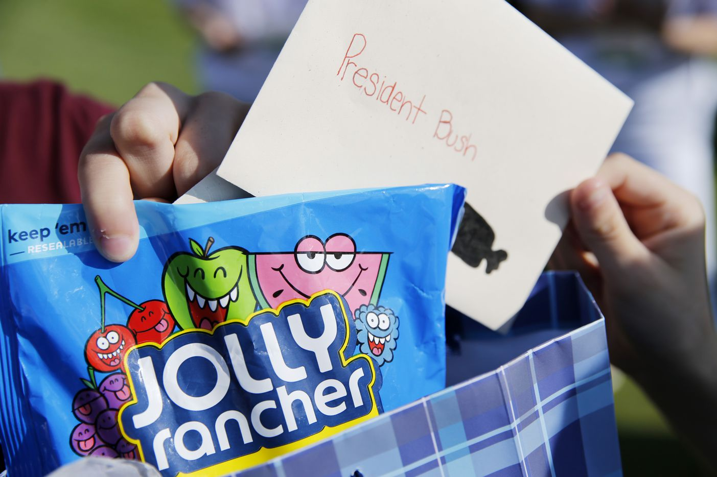 Detail of the Jolly Ranchers and cards that the family of staff sergeant Andrew Bachelder gave to George W. Bush, 43rd President of the United States during the Warrior Open at the Trinity Forest Golf Club in Dallas on Monday, May 21, 2018.