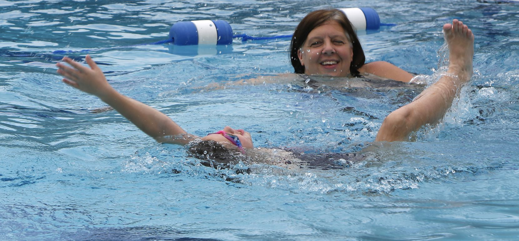 Beckie Koelpin looks on as her daughter Ellie practices her backstroke form at the Lake Highlands Aquatic Center.