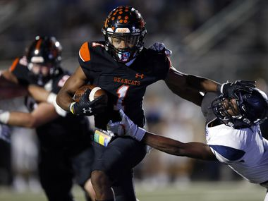 Aledo wide receiver JoJo Earle stiff-arms Frisco Lone Star linebacker Devin Turner (8) during Aledo's 34-32 win Friday. (Tom Fox/The Dallas Morning News)
