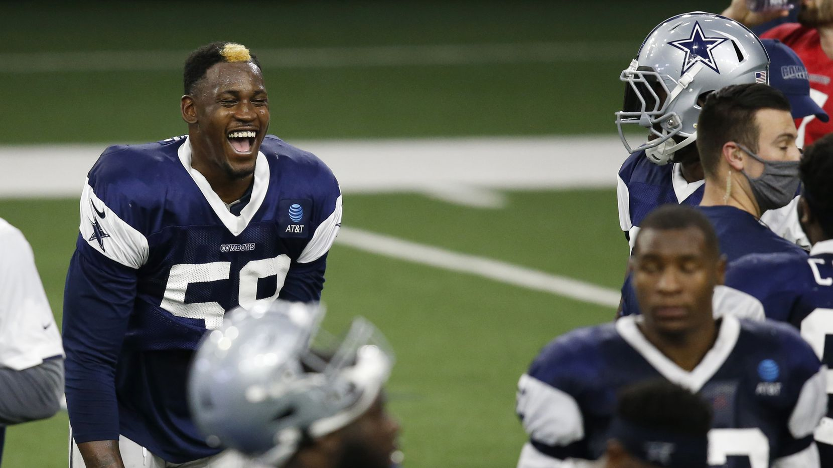 Dallas Cowboys defensive end Aldon Smith (58) laughs as he talks with Dallas Cowboys defensive end DeMarcus Lawrence (90) during a break in practice during training camp at the Dallas Cowboys headquarters at The Star in Frisco, Texas on Monday, August 31, 2020.