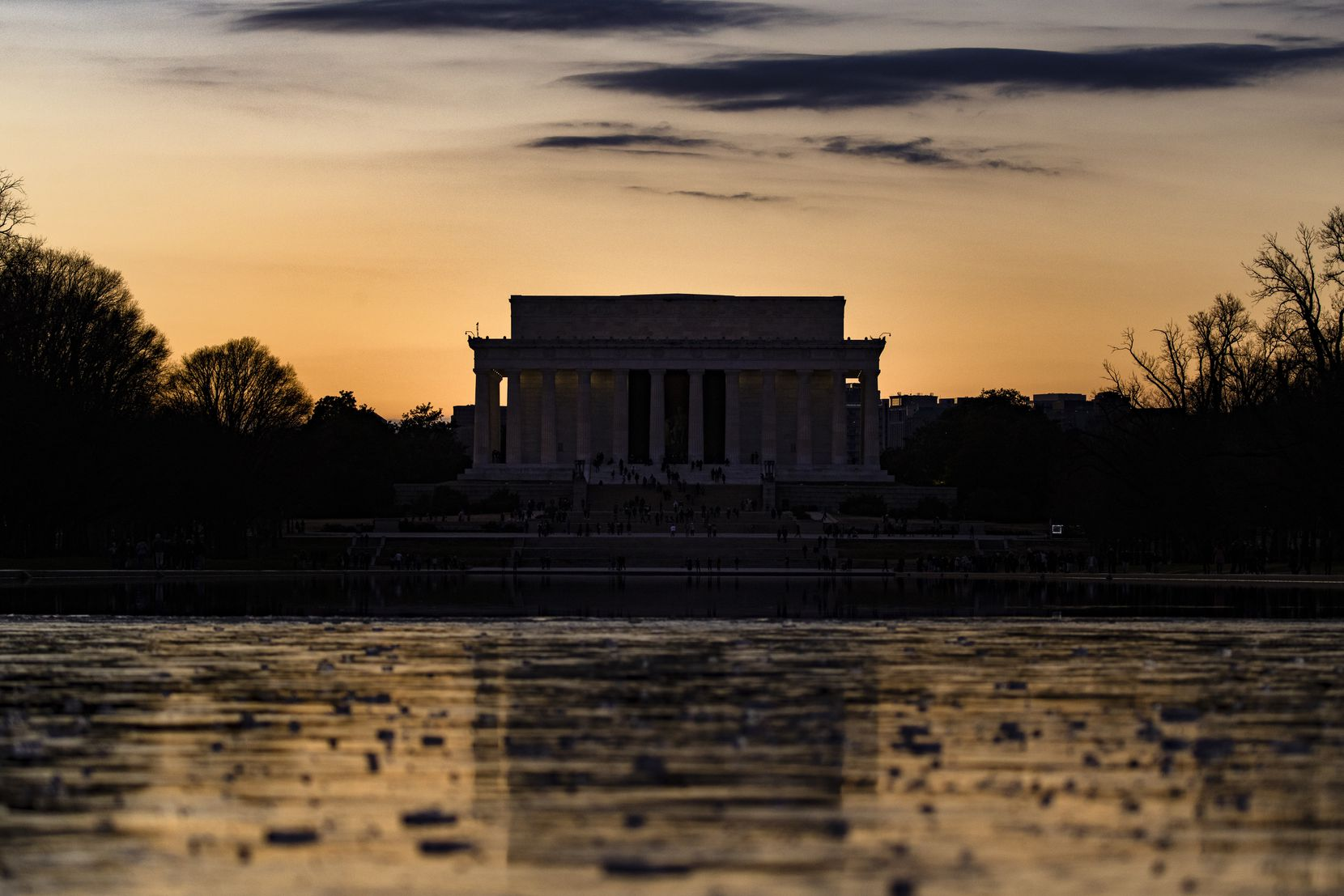 The Lincoln Memorial is seen across the Reflecting Pool at sunset on Saturday, Dec. 26, 2020, in Washington, D.C.