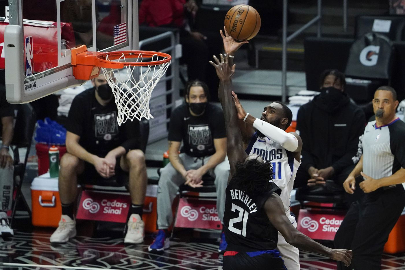 Dallas Mavericks forward Tim Hardaway Jr. (11) shoots over LA Clippers guard Patrick Beverley (21) during the second half of an NBA playoff basketball game at Staples Center on Tuesday, May 25, 2021, in Los Angeles. The Mavericks won the game 127-121.