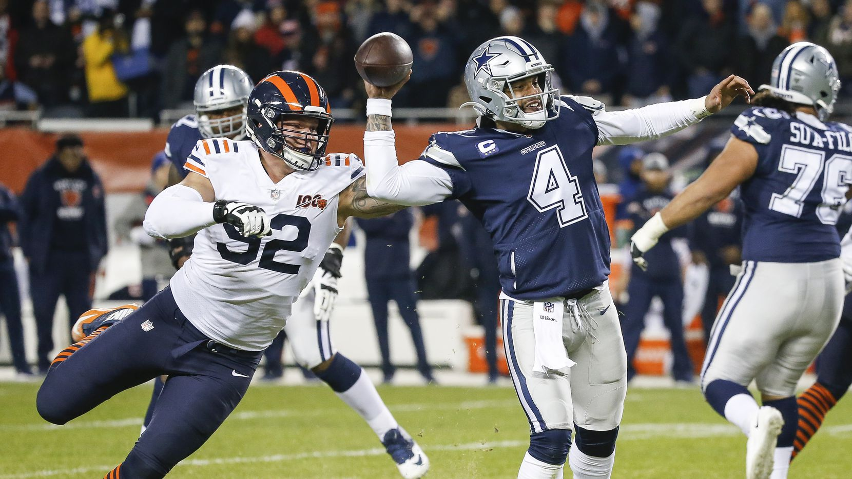 Dallas Cowboys quarterback Dak Prescott (4) fires off a pass before being brought down by Chicago Bears defensive end Brent Urban (92) during the second half a NFL matchup between the Dallas Cowboys and the Chicago Bears on Thursday, Dec. 5, 2019, at Soldier Field in Chicago. (Ryan Michalesko/The Dallas Morning News)