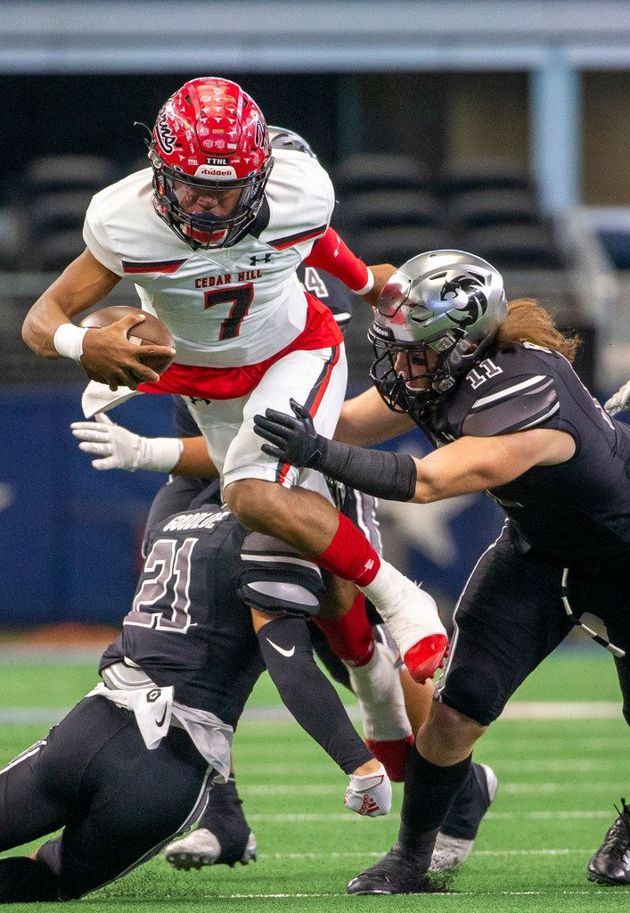 Cedar Hill quarterback Kaidon Salter (7) gets sacked by Denton Guyer linebacker Cole Ramsey (11) during the Class 6A Division II area-round high school football playoff game at the AT&T Stadium in Arlington, Texas, on Saturday, November 23, 2019. (Lynda M. Gonzalez/The Dallas Morning News)