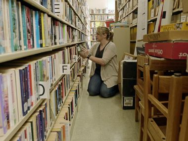 A library clerk shelves books in this file photo.