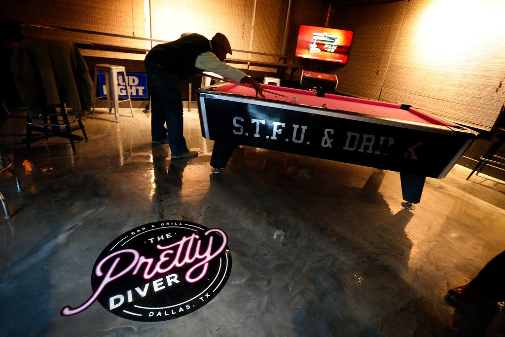 A gentleman plays pool at The Pretty Diver bar at 3030 Ross Ave. near downtown Dallas