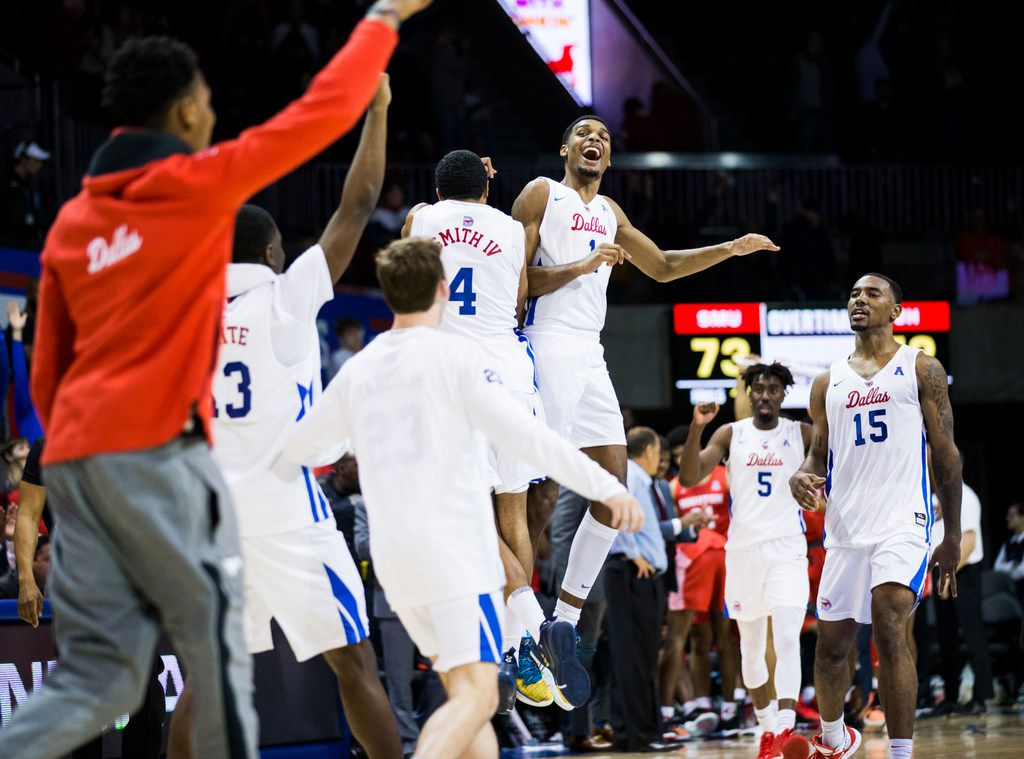Southern Methodist Mustangs celebrates a 73-72 win in overtime of a basketball game between SMU and University of Houston on Saturday, February 15, 2020 at Moody Coliseum in Dallas. (Ashley Landis/The Dallas Morning News)