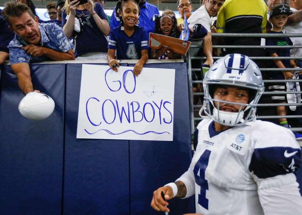 Dallas Cowboys quarterback Dak Prescott (4) signs autographs following Dallas Cowboys practice Monday, Aug. 26, 2019 at The Star in Frisco.
