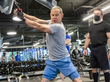 Bill Kritzer works out with Trophy Fitness trainer John Gordon at the Uptown gym on May 18, 2020 in Dallas. Kritzer said he kept active by doing a lot of cardio, running, and push-ups while the gym was closed.