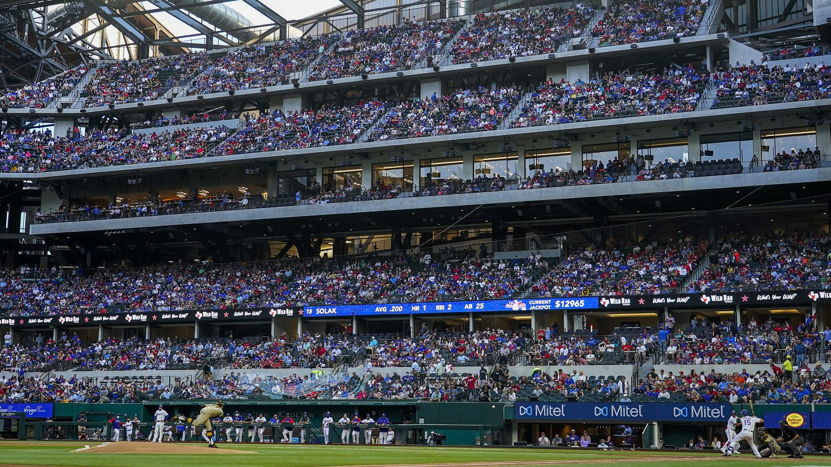 San Diego Padres starting pitcher Chris Paddack delivers to Texas Rangers second baseman Nick Solak during the second inning in front of a crowd of 35,856 at Globe Life Field on Saturday, April 10, 2021.