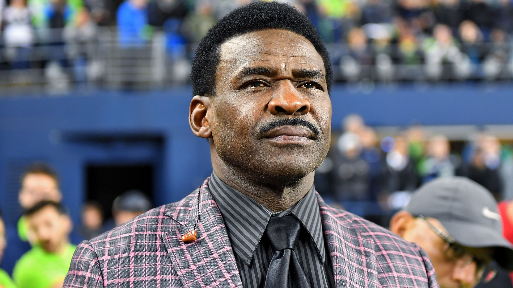 FILE — HOF wide receiver Michael Irvin of the Dallas Cowboys watches the game against the Seattle Seahawks and the Los Angeles Rams at CenturyLink Field on October 03, 2019 in Seattle, Washington.