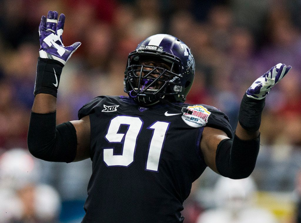 TCU Horned Frogs defensive tackle L.J. Collier (91) celebrates a hit during the fourth quarter of the Valero Alamo Bowl between TCU and Stanford on Thursday, December 28, 2017 at the Alamodome in San Antonio. (Ashley Landis/The Dallas Morning News)