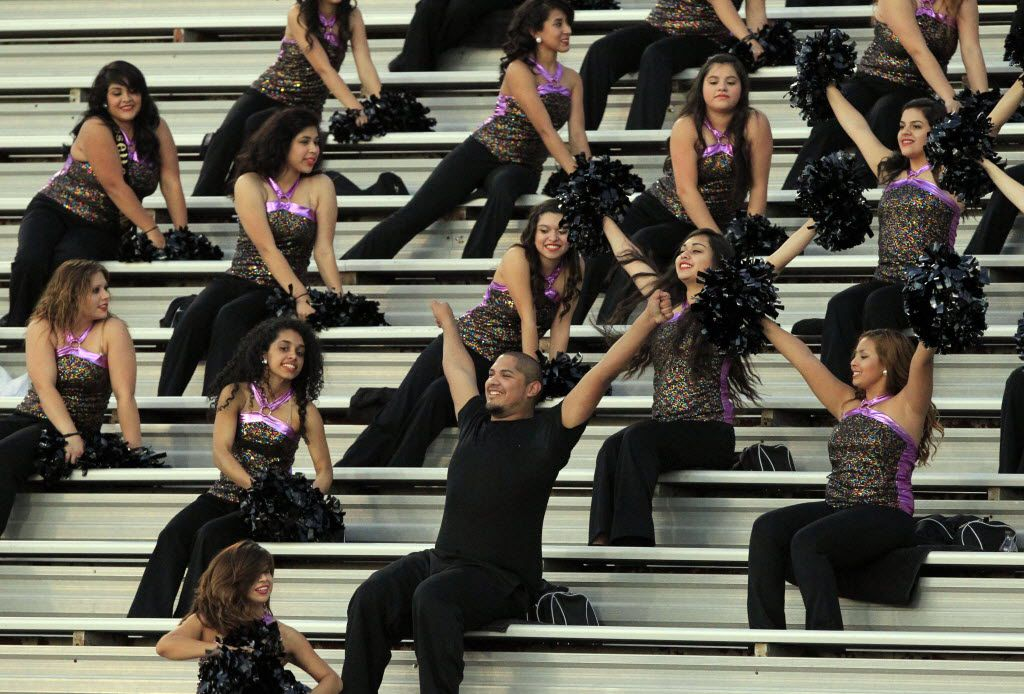 Members of the Dallas Molina High perform a routine in the bleachers during the first quarter of a high school football game against Dallas Pinkston High at the Sprague Athletic Complex/Jones Field in Dallas on Thursday, September 26, 2013. (John F. Rhodes / Special Contributor)