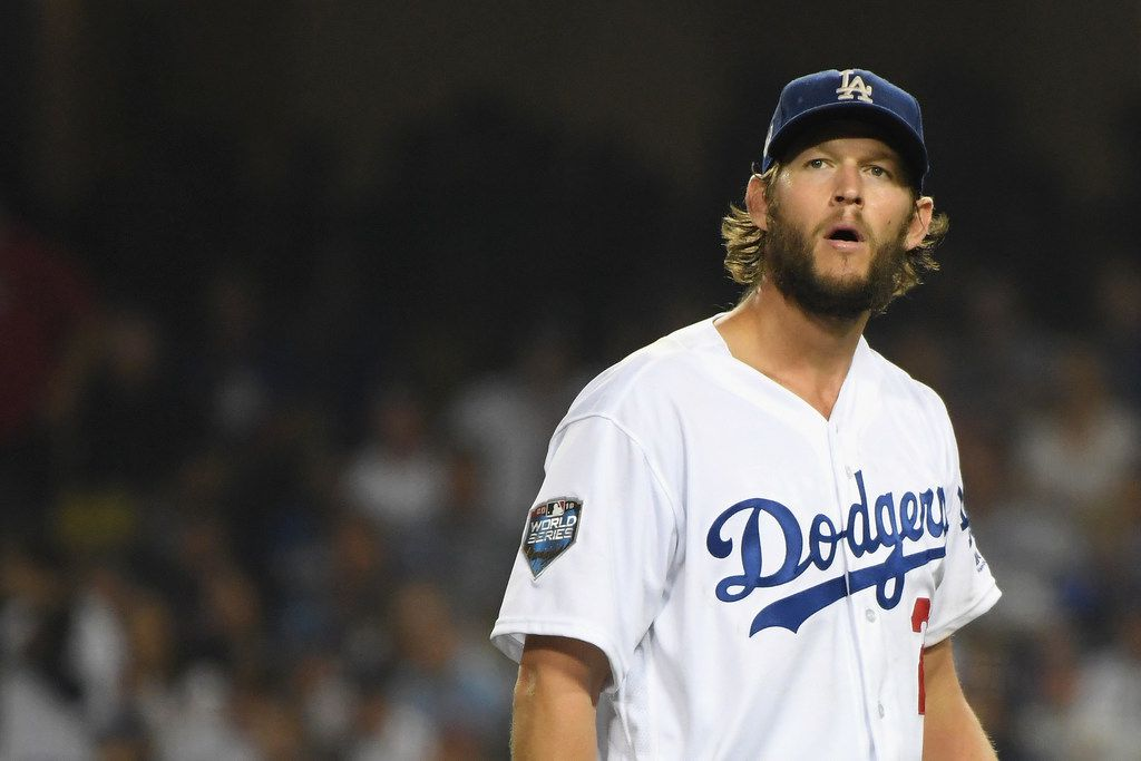 LOS ANGELES, CA - OCTOBER 28:  Clayton Kershaw #22 of the Los Angeles Dodgers reacts during the sixth inning against the Boston Red Sox in Game Five of the 2018 World Series at Dodger Stadium on October 28, 2018 in Los Angeles, California.  (Photo by Harry How/Getty Images)